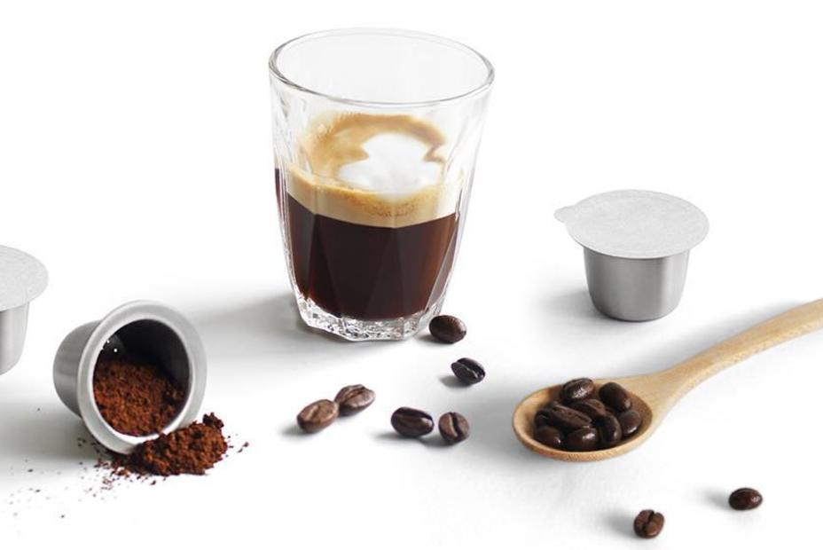 A glass of coffee made with reusable coffee pods